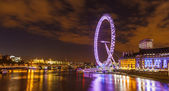 London skyline with the London Eye at night. — Stock Photo