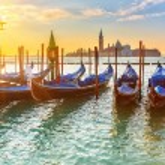Venetian gondolas at sunrise — Stock Photo #44644381