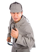 Curious Sherlock Holmes pipe and magnifying glass — Stock Photo
