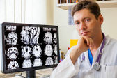 Doctor with an MRI scan of the Brain — Stock Photo
