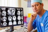 Experienced doctor with an MRI scan — Stock Photo