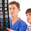 Two doctors looking at tomogram — Stock Photo