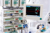 Patient with monitor and infusion pumps in an ICU — Stock Photo