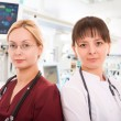 Stock Photo: Two female doctors in ICU