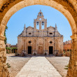 Stock Photo: Old monastery behind the Arch.Arkadi monastery - Crete, Greece.
