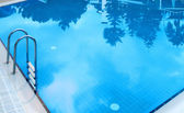 Swimming pool with reflections — Stock Photo