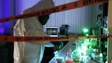 Scientist behind the caution tape laboratory with equipment — Stock Video