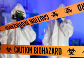 Two scientists in hazardous laboratory. — Stock Photo