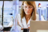 Young woman scientist in laboratory  — Foto Stock