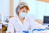 Woman scientist in laboratory — Stock Photo