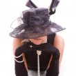 Lying womenlooking from the hat — Stock Photo #6097060