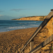 Wooden rail at beach - Stock Photo