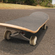 Skateboard on asphalt footpath  — Stock Photo