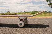 Closeup to skateboard of asphalt — Stock Photo