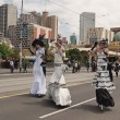Stock Photo: Ladies on stilts on parade