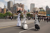 Ladies on stilts on parade — Stock Photo