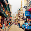 Narrow crowded street with many shops and restaurants in the centre of Macau. — Stock Photo #13815843