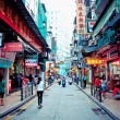 Narrow crowded street with many shops and restaurants in the centre of Macau. — Stock Photo