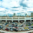 Panoramic view of giant parking lot and Bangkok skyline — Stock Photo