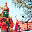 Stock Photo: Guardian statue next to satellite dish in temple, Koh Samui - Thailand