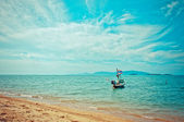 Boat with national flag, beach and sea in Koh Samui — Stock Photo