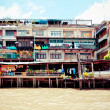 Buildings along the Chao Phraya River in Bangkok — Stock Photo