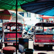 Typical tuk tuk taxis parked and traffic in Bangkok, Thailand — Stock Photo