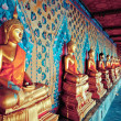 Gloden statues of Buddha in Wat Arun temple, Bangkok — Stock Photo #18795289