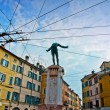 Parma, Italy - colorful Mediterranean architecture and monument to soldier — Stock Photo #23610471