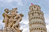 Leaning Tower of Pisa with angels statue, Tuscany - Italy — Stock Photo