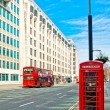 British icons red phone booth and red bus in London — Stock Photo