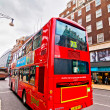 British icon double decker bus along Oxford Street in London, UK — Stock Photo