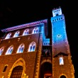 Stock Photo: Night view of downtown with enlightened Town Hall in Piombino, Italy