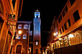 Night view of downtown with enlightened Town Hall in Piombino, Italy — Stock Photo