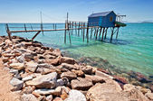 Choza azul pescadores en la costa toscana — Foto de Stock