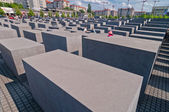The Holocaust Memorial and modern buildings in Berlin — Stock Photo
