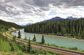 River, railway and Rocky Mountains in Banff National Park, Alberta — Stock Photo