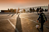Children playing football at sunset in Naples, Italy — Stock Photo