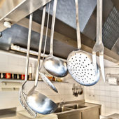 Cooking utensils in a professional kitchen — Foto Stock