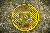 """""""Gas"""" on Manhole Cover — Stock Photo"""