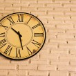 Clock on brick wall — Stock Photo