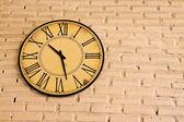 Clock on brick wall — Stock Photo