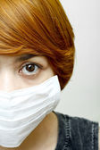 Woman wearing protective mask — Stock Photo