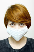 Woman wearing protective mask — Stockfoto