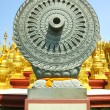 Carved stone Dhammajak — Stock Photo