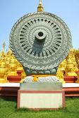 Carved stone Dhammajak — Stock Photo