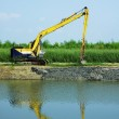 Excavator dredging the canal — Stock Photo #33708137