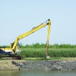 Excavator dredging the canal — Stock Photo #34637811
