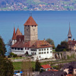 Spiez Church with Lake of Thun Switzerland - Stock Photo