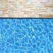 Royalty-Free Stock Photo: Modern brick pavement with pool edge background